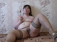 Young fatty on heels showing figure and masturbating
