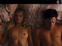 Lovely and sexy Margot Robbie flashes tits while doing some kind of bed scenes