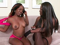 Two ebony models Xena and Coco Dior have some fun with a strapon